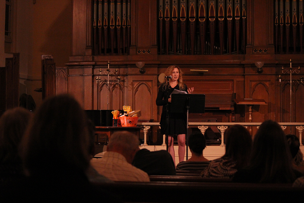Photo of poet Sage Cohen speaking at the Old Church.